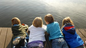 children by lake